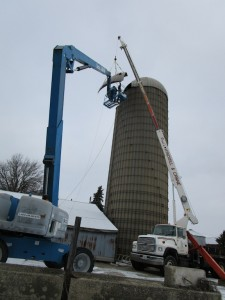 Crane and Two Man Lift Installing Grain Silo Cover