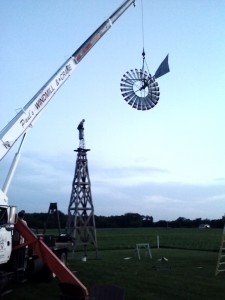 Lifting windmill onto wood tower